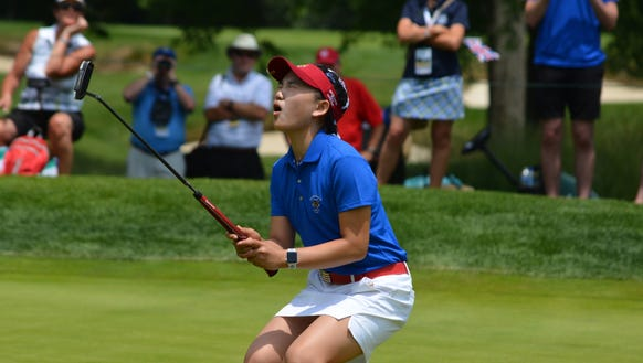 U.S. team member Lucy Li, 15, reacts after missing