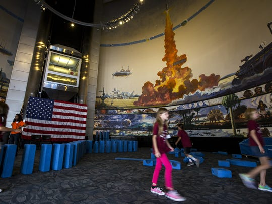 Summer camp attendees play in front of Robert McCall's