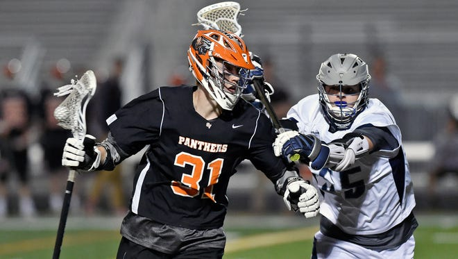 In this file photo, Central York's Connor Hoch drives against Dallastown's Robbie Pugh during action last season. Hoch returns for the defending league champions.