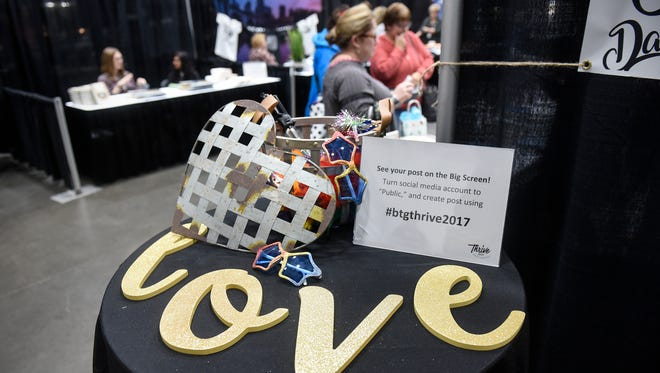 Decorations reflect the theme of the annual Thrive Conference which began Friday, Oct. 13, at the River's Edge Convention Center in St. Cloud.