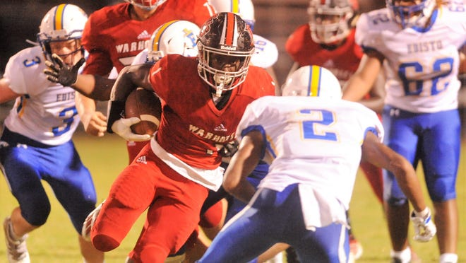 TJ Miller, #1 of the Warhorses, breaks loose for a big gain in Thursday's season opener against Edisto High.