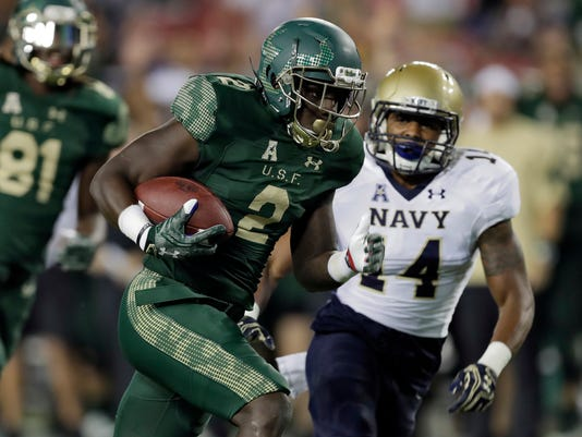 South Florida running back D'Ernest Johnson (2) runs past Navy cornerback Elijah Merchant (14) to score on a 23-yard touchdown run during the first quarter of an NCAA college football game Friday, Oct. 28, 2016, in Tampa, Fla. (AP Photo/Chris O'Meara)