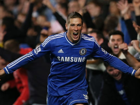 "FILE - In this Sunday, Oct. 27, 2013, file photo, Chelsea's Fernando Torres celebrates after scoring the winning goal during the English Premier League soccer match between Chelsea and Manchester City. Chelsea says it has agreed terms with AC Milan for striker Fernando Torres to join the Serie A club in a two-year loan deal. The Premier League club said in a statement that ""the move is now subject to Fernando agreeing personal terms with AC Milan and passing a medical examination."" The deal was announced a few hours after Chelsea manager Jose Mourinho had raised the prospect of Torres leaving before the transfer window closes, saying the Spain striker may be ready to ""try a new life, a new club, probably a new league."" Torres joined Chelsea from Liverpool in January 2011 for what was then a British-record fee of 50 million pounds (then $81 million), but has struggled to command a regular starting place for the London club. (AP Photo/Alastair Grant, File)"