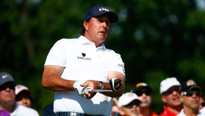 Phil Mickelson plays a shot on the second hole during the final round of the Memorial Tournament presented by Nationwide Insurance at Muirfield Village Golf Club on June 1, 2014 in Dublin, Ohio.