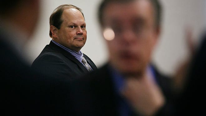 In this July 15, 2015 file photo, Eddie Tipton looks over at his lawyers before the start of his trial in Des Moines. The former security director of the Multi-State Lottery Association, accused of tampering with lottery drawings to rig jackpots in four states, was convicted of fraud in the attempt to claim a $16.5 million jackpot in Iowa.