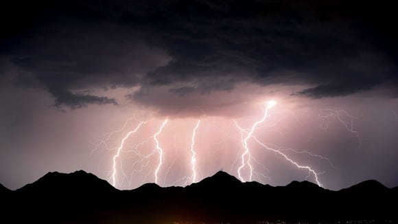 Lightning streaks across the desert sky over the McDowell