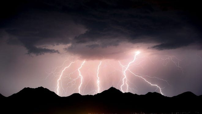 Lightning streaks across the desert sky over the McDowell Mountains during a monsoon storm. Rob Schumacher/The Republic Lightning fires across the desert sky over the McDowell Mountains during a monsoon storm in Scottsdale, AZ. Rob Schumacher/The Arizona Republic