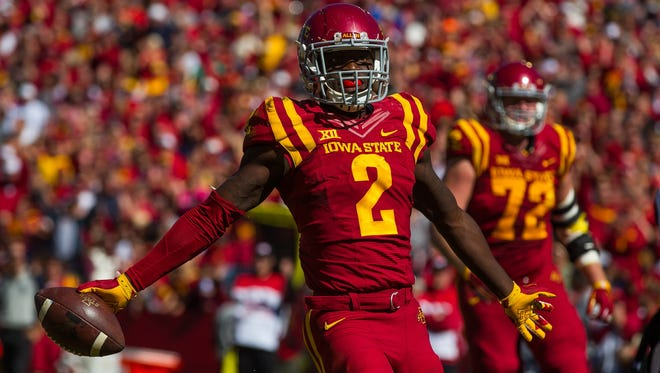 Iowa State's Mike Warren celebrates a touchdown during their game against Kansas at Jack Trice Stadium in Ames on Saturday, October 3, 2015.