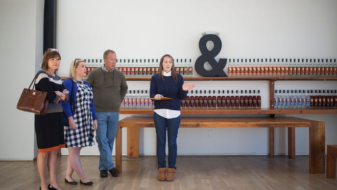 Copper and Kings American Brandy Company  Manager of Consumer & Customer Experience, Jenn Desjardins, right, takes Susan Howard, far left, Meredith Howard, center and Bill Howard on a tour of the distillery on Wednesday, October 21, 2015, in Louisville, Ky. Meredith Howard plans on using the distillery as the location for her wedding ceremony and reception.