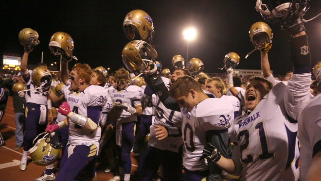 Norwalk players cheer with their fans following a Class 3-A quarterfinal win. Norwalk defeated Dallas Center-Grimes 19-14 in a Class 3-A state quarterfinal in Grimes Nov. 6.