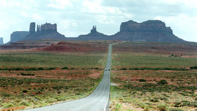Highway 163 snakes through Monument Valley on the Navajo Reservation.