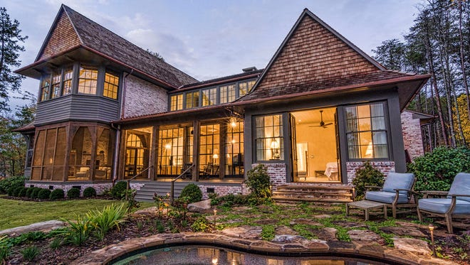This home was intentionally designed and constructed to aesthetically improve with age. Centuries-old, European style meets new construction on this Lake Keowee home.