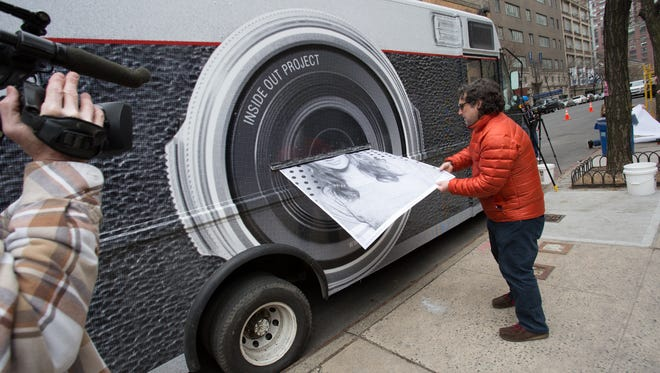 """As part of JR's global portrait project, """"Inside Out,"""" a traveling photo booth will visit three Nashville neighborhoods to make massive murals of printed portraits that will be installed at OZ Arts during the weeklong fest."""