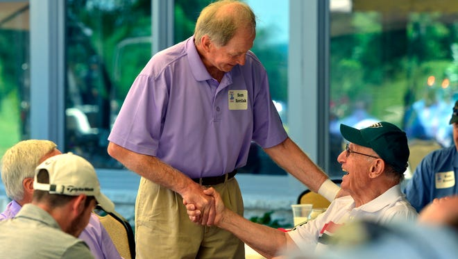 Dr. Sam Havrilak, a member of the Colt's 1970 Super Bowl team, left, greets former Eagles running back Joe Pagliei during the the Eddie Khayat-George Tarasovic Celebrity Golf Classic, Monday, June 20, 2016. John A. Pavoncello photo