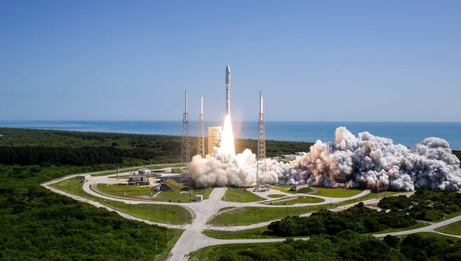 A United Launch Alliance Atlas V rocket carrying the Navy's fifth Mobile User Objective System satellite blasted off from Launch Complex 41 at Cape Canaveral Air Force Station on Friday, June 24, 2016.
