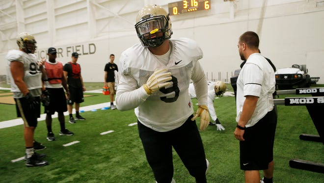 Lorenzo Neal runs through blocking sled drills during football practice Monday, August 15, 2016, in the Mollenkopf Athletic Center on the campus of Purdue University.