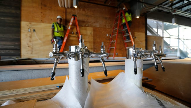 Construction was underway last week on the Thunderbird Taproom, which will sell beer on tap, wine, and include a restaurant, inside the new Whole Foods Market store opening next month in West El Paso.