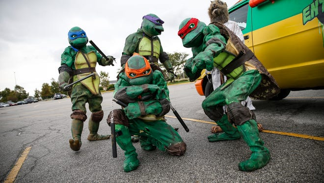 Ninja Turtles, part of Turtle Time Entertainment, make a stop at the Castleton Mall parking lot on Sept. 28, 2016.