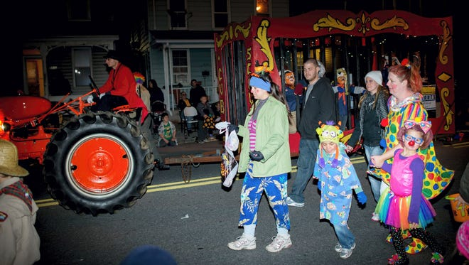 Parade participants march along Baltimore Street during the Hanover Halloween Parade on Oct. 30, 2014.