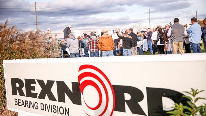 Employees of Rexnord Bearings in Indianapolis, local union reps and family members of the employees protest Rexnord's decision to likely move 300 jobs to Mexico on Nov. 11, 2016.