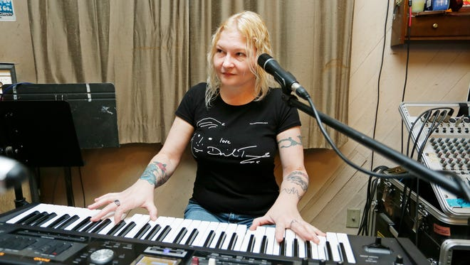 Erica Hegland on keyboards as members of Graciously Departed rehearse Wednesday, March 15, 2017, south of Lafayette.