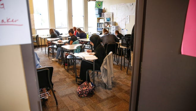 Herron High School students work on their exams on the last day of school on Thursday, May 25, 2017.