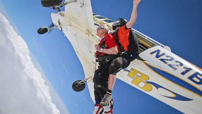 James Diggle and instructor Ryan Kramer freefall toward Earth at Skydive Indianapolis in Frankfort, Ind., Sunday, June 18, 2017. Diggle skydived with three family members for Father's Day, a gift from his daughter Kimberly Dove. The 83-year-old legally blind Korean War veteran served in the 82nd Airborne Division and accumulated over 887 jumps between military parachuting and recreational skydiving. After more than 40 years since his last jump, Diggle jumped tandem with his family, checking an item off his bucket list.