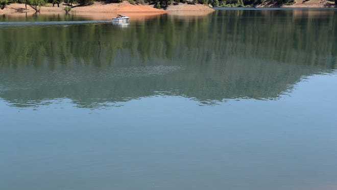 A boat moves across Lake Shasta on Wednesday. U.S. Bureau of Reclamation officials say in the summertime more than 200 million gallons of water are lost to evaporation daily on the lake.