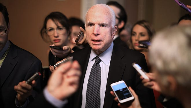 Sen. John McCain, R-Ariz., leaves a meeting where a new version of a GOP healthcare bill was unveiled to Republican senators at the U.S. Capitol on July 13, 2017, in Washington, D.C. McCain's office announced Wednesday, July 19, 2017, that the senator has brain cancer called glioblastoma.