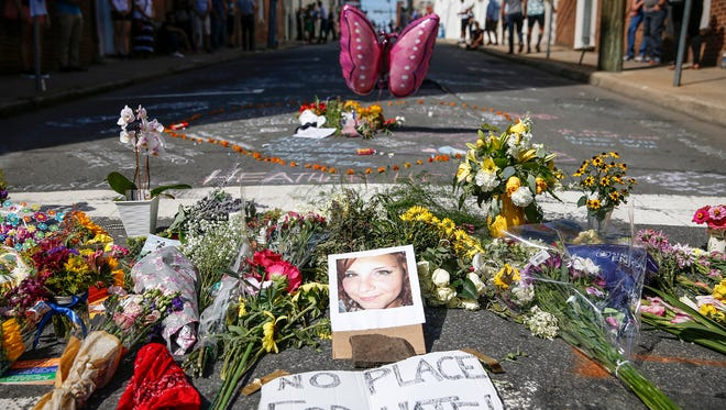 Flowers and notes are left in memory of Heather Heyer, who died after she was struck when a car plowed into a crowd protesting the 'Unite the Right' rally on Saturday, in Charlottesville on Sunday, August 13, 2017.