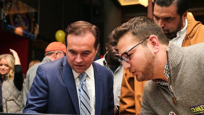 Cincinnati Mayor John Cranley, left, and political consultant Jared Kamrass view election results during the 2017 mayoral race.