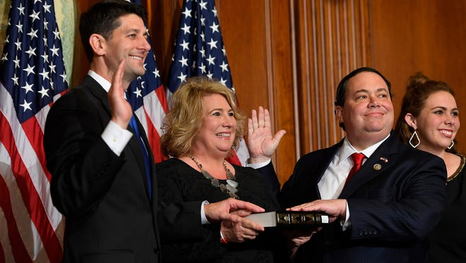 Rep. Blake Farenthold, R-Texas, and his wife Debbie Farenthold stand with House Speaker Paul Ryan, R-Wis., for a ceremonial swearing-in and photo-op during the opening session of the 115th Congress on Jan. 3, 2017, on Capitol Hill in Washington. It was announced Thursday, Dec. 14, 2017, that he will not seek another term.