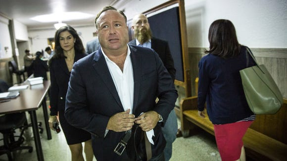 "In this Monday, April 17, 2017 photo, ""Infowars"" host Alex Jones arrives at the Travis County Courthouse in Austin, Texas."