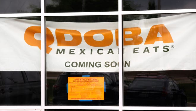 A large sign hangs in the window of the future location of a Qdoba Mexican Grill Monday, June 11, 2018, in the Lafayette Shoppes at the corner of Farabee Drive and South Street in Lafayette. Allegedly, the restaurant was to have opened in May.
