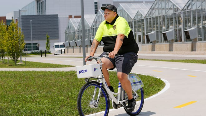 Aaron Madrid takes a new Pace bicycle from Zagster for a spin Thursday, July 12, 2018, on the campus of Purdue University. Madrid said 200 of the Pace bicycles will be placed on campus in August. The use of the bicycles will be monitored and more bicycles will be added as needed. Madrid is alternative transportation coordinator at Purdue.
