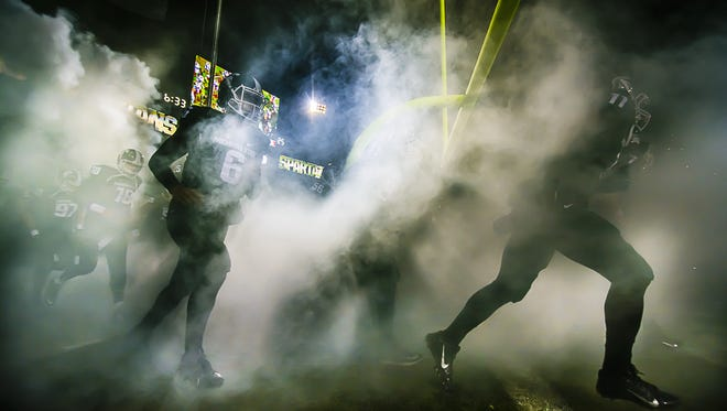 Members of the MSU football take the field prior to their showdown with Ohio State Saturday November 8, 2014 at Spartan Stadium in East Lansing.  KEVIN W. FOWLER PHOTO