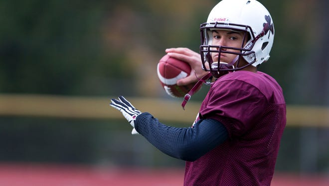 Aquinas quarterback Jake Zembiec passes the ball during practice at Aquinas Institute on Wednesday, October 29, 2014.