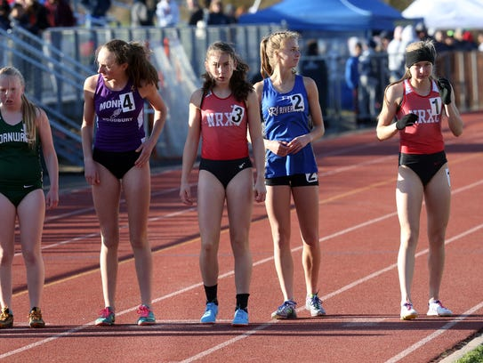 Runners wait for the start of the girls 3200 meter