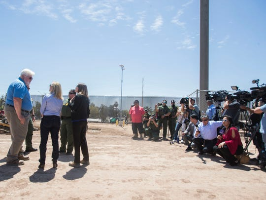 Third from left, Department of Homeland Security Secretary Kirstjen Nielsen surveys the international border in Calexico, California on April 18, 2018.