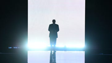 Donald Trump emerges on stage to introduce his wife, Melania Trump, at the Republican National Convention Monday night.