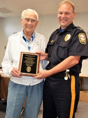 Charlie Kercher, left, was honored by Cleona Borough Council with a plaque for 18 years of service as a crossing guard. He was presented the award by Chief Jeff Farneski, right.