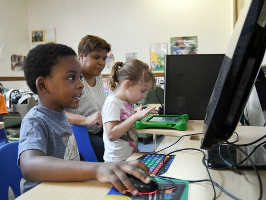Pre-K student Ethan Ware, 4, participate in class activities