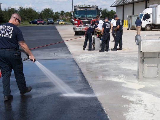 John Pinto, a firefighter/EMT with South Trail Fire & Rescue, cleans up after a training session for Arthrex employees Thursday in Fort Myers. South Trail is asking voters to approve a tax increase.