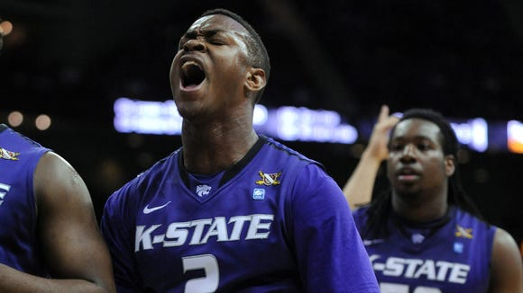 Mar 13, 2014; Kansas City, MO, USA; Kansas State Wildcats guard Marcus Foster (2) celebrates after scoring during the first half against the Iowa State Cyclones in the second round of the Big 12 Conference college basketball tournament at Sprint Center. Mandatory Credit: Denny Medley-USA TODAY Sports