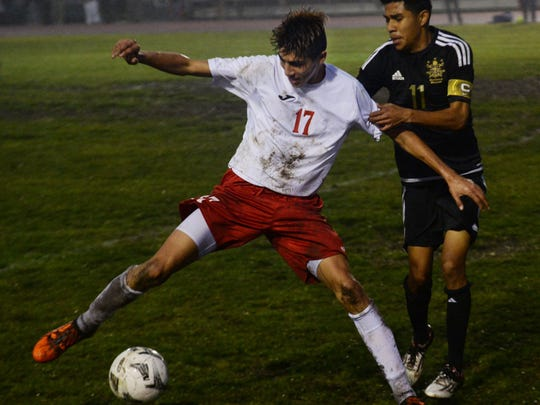 Hueneme's J.P. Ortiz, left, fending off Cesar Juarez of Channel Islands during a game last season, is one of the top returning players for the Vikings this season.