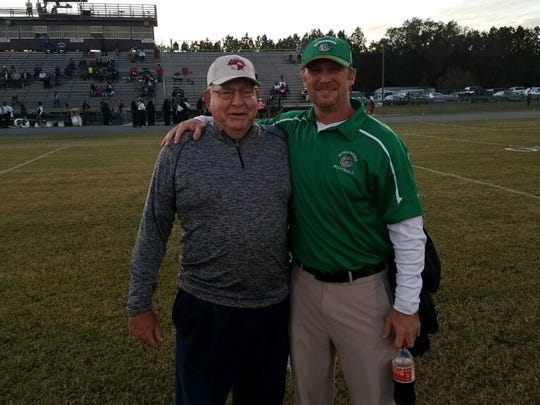 Former FSU defensive coordinator Mickey Andrews visits with former player Kyler Hall, who moved on from his DB career with the Seminoles to become a head coach at Maclay and now his alma mater Live Oak Suwannee.