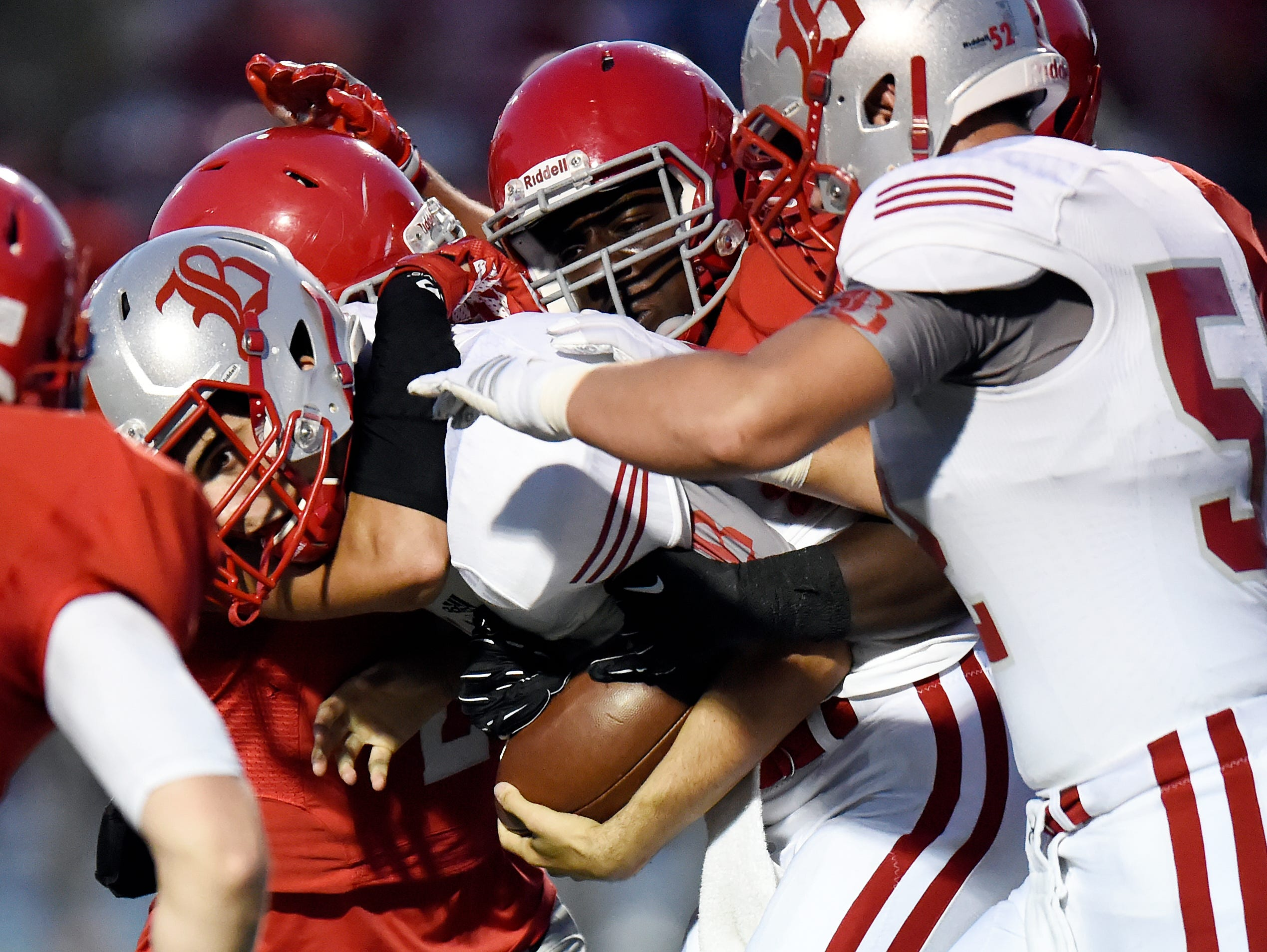 Baylor quarterback Lorenzo White, center, is sacked by Brentwood Academy defenders during first half of an high school football game on Friday, Sept. 16, 2016, in Brentwood, Tenn.