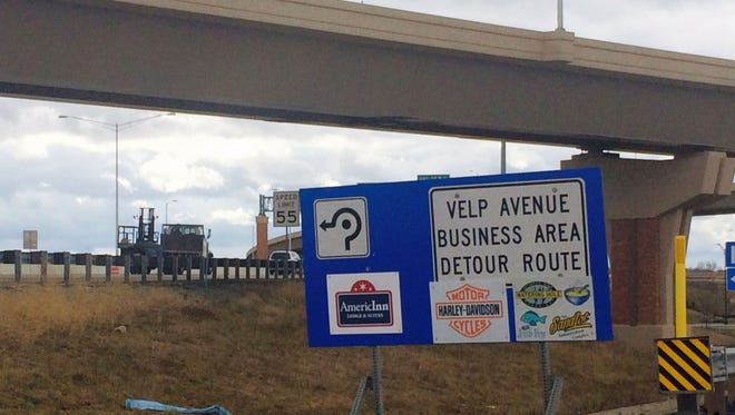 A detour sign stands at the Interstate 41 southbound off-ramp near Shawano Avenue in Howard for reaching businesses impacted by the ongoing roadwork in the Velp Avenue area.