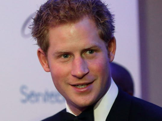 Britain's Prince Harry arrives to attend the Sentable 'Forget Me Not' dinner on October 7, 2013 in Dubai