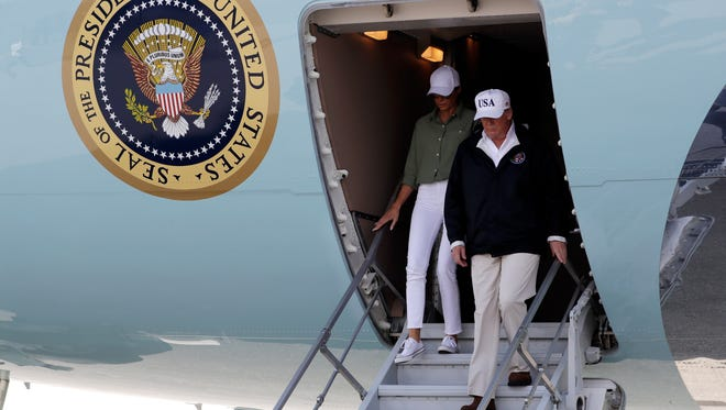 President Donald Trump and first lady Melania Trump arrive at Southwest Florida International airport to meet with first responders and people impacted by Hurricane Irma, Thursday, Sept. 14, 2017, in Ft. Myers, Fla. (AP Photo/Evan Vucci)